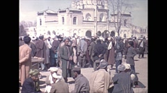 Vintage 16mm film, 1970, Afghanistan, Kabul, people crowded market, orange cart Stock Footage
