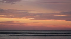 Small waves at sea during sunset Stock Footage
