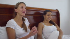 4K Happy family life - gay female couple relaxing in bed with young daughter - stock footage