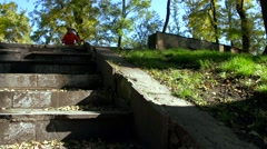 The child rides a bicycle on autumn park Stock Footage