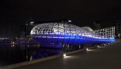 4k moving shot of Webb Bridge in Docklands, Melbourne at night Stock Footage