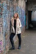 Beautiful girl posing in an urban context - stock photo