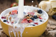 Cornflakes with fresh Fruits and Milk Stock Photos