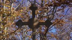 Sunlight moves Christian cross with a background autumn trees Stock Footage