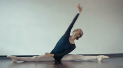 Ballet girl stretches and warming up,dolly shot Stock Footage