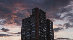 Isolated skyscraper and moving clouds, dramatic sky, Timelapse. Stock Footage