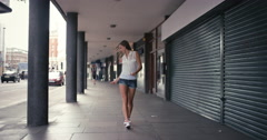 Contemporary funky caucasian woman street dancer dancing freestyle in the city Stock Footage