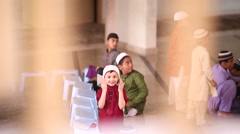 Smiling Kid Inside a Mosque Stock Footage