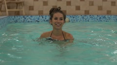 Pregnant woman smiling doing aquafit class Stock Footage