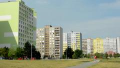 View of the large evergreen park before large building complex - people walk  Stock Footage