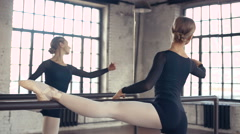 Female Ballet Dancer stretches and practices,dolly shot Stock Footage