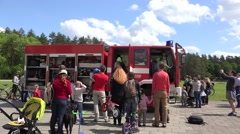 People around military fire fighter rescue truck. 4K Arkistovideo