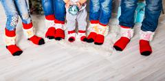 Stock Photo of Happy family with Christmas socks. Winter holiday concept