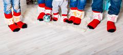 Happy family with Christmas socks. Winter holiday concept Stock Photos