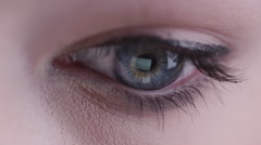 Close-up sliding shot of woman eyes with working tablet screen reflection - stock footage
