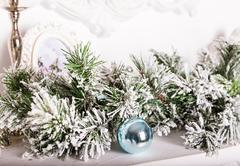 Christmas decorations on the mantelpiece Stock Photos