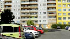 View of the street with many cars before the prefab houses complex in the suburb Stock Footage