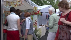 Stock Video Footage of tourists and citizen people buy souvenirs at street market. 4K