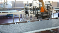 Factory production conveyor of extruded polypropylene foam - thermal insulation Stock Footage