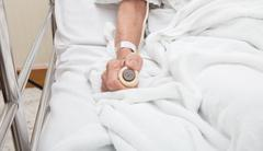 Hand pressing emergency nurse call button - stock photo