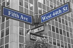 Street signs for Fifth Avenue and West 44nd street Stock Photos