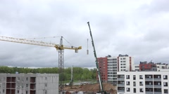 Industrial crane disassembling in construction site. 4K Stock Footage