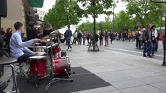 Drummer of young musicians band play lyric music. 4K - stock footage