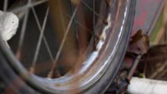 Spin old rusty spoked wheel Stock Footage