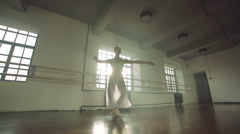Graceful girl practicing ballet in the Studio, slow motion , performs the Stock Footage