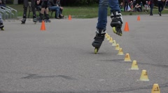 Amateur roller skater do acrobatic with cones in competition. 4K - stock footage