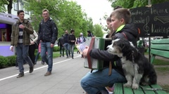 Stock Video Footage of boy kid play with accordion squeeze box. Small dog. 4K