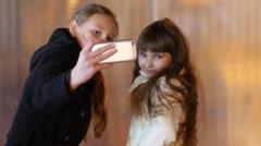 Two cute kid girls take selfie photo shot for instagram having fun Stock Footage