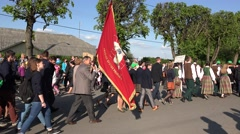 People with national clothes and flag walk town parade ceremony . 4K Stock Footage