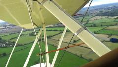 Aerial footage flying over the English countryside in a vintage bi-plane Stock Footage