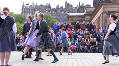 Scottish folk dancers.Wearing  kilth and traditional clothes Stock Footage