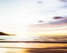 Abstract seascape with blurred panning motion on paper background - stock photo