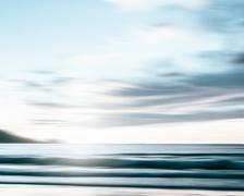 An abstract seascape with blurred panning motion on paper background Stock Photos