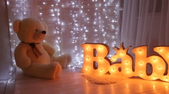 Baby room with big teddy bear - stock footage