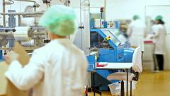 Workers at Pharmaceutical Packaging Production Line Stock Footage
