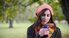 Happy girl smiling  and wathing at camera. Girl dressed in a sweater, hat and - stock footage
