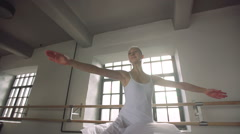 graceful girl practicing ballet in the Studio, slow motion , does pirouettes - stock footage