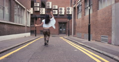 Contemporary funky asian woman street dancer dancing freestyle in the city Stock Footage