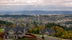 Time Lapse of clouds over Happy Valley Oregon residential suburbs homes in fall Stock Footage