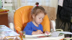 Little kid girl painting drawing watercolor aquarelle at home Stock Footage