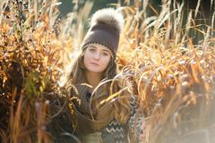 Young girl in a reed Stock Photos