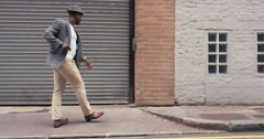 Contemporary funky African American man street dancer dancing freestyle in the Stock Footage
