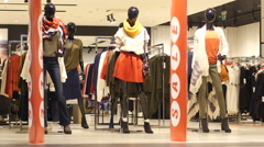 Mannequins and sale discount in a fashionable clothes store Stock Footage