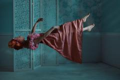 Girl floating in the room. - stock photo