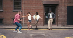 Group of multi-racial dancers street dancing funky freestyle in the city Stock Footage