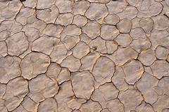 Broken surface of a salt and clay pan or playa Tassili n´ Ajjer Algeria Sahara - stock photo